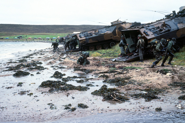 Combat-ready Marines of the 4th Marine Amphibious Brigade charge out of LVTP-7 tracked landing vehicles on Red Beach during the NATO exercise Northern Wedding