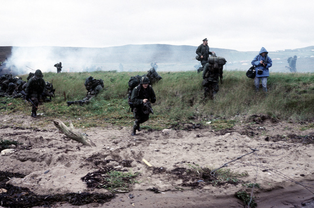 Combat-ready U.S. Marine infantrymen and tanks move toward their objective on Red Beach. The 4th Marine Amphibious Brigade is participating in the NATO exercise Northern Wedding