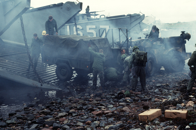 Marines of the 4th Marine Amphibious Brigade (4th MAB) unload some of their equipment from two of the LCM-8 mechanized landing craft beached at Red Beach. The 4th MAU is participating in the NATO Exercise Northern Wedding
