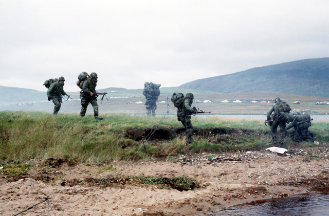 Members of a Marine combat-ready squad wear their field protective masks during their training with members of the NATO forces. The 4th Marine Amphibious Brigade is participating in the NATO exercise Northern Wedding on Red Beach
