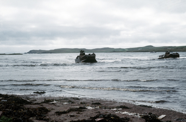 Two personnel tracked landing vehicles (LVTP-7) prepare to come ashore on Red Beach during a NATO exercise. The 4th Marine Amphibious Brigade is participating in the NATO exercise Northern Wedding