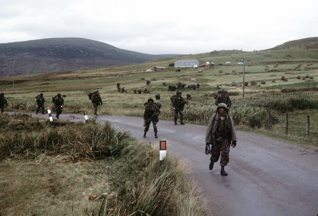 U.S. Marines march down a road toward their objective. The 4th Marine Amphibious Brigade is participating in the NATO exercise Northern Wedding