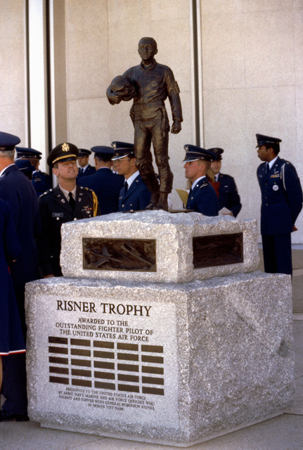 A statue is dedicated in honor of Brigadier General Robinson Risner (USAF, Ret.) during a ceremony at the US Air Force Academy. Risner was shot down over North Vietnam in 1965 and served as vice commander of the 4th Allied Prisoner of War Wing until he was repatriated in 1973