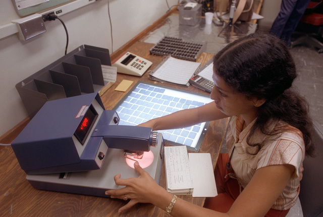 Radiation Dosimetry SPECIALIST Rachel Rodriguiz evaluates the density of dosimeter film in the Occupational and Environmental Health Laboratory. Rodriguiz is responsible for reading all Air Force, Air National Guard and Air Force Reserve film badges