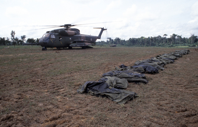 A US Air Force HH-53 Jolly Green Giant helicopter from the 55th Aerospace Rescue and Recovery Squadron stands by to assist in the removal of the remains of the victims of the Jonestown tragedy
