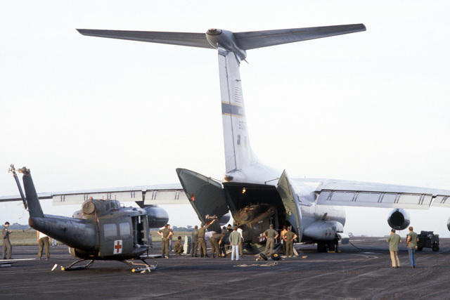 US Army UH-1 Iroquois helicopters are loaded aboard a C-141 Starlifter aircraft for transport back to their home base in the Canal Zone. The helicopters were used during humanitarian relief efforts following the Jonestown tragedy