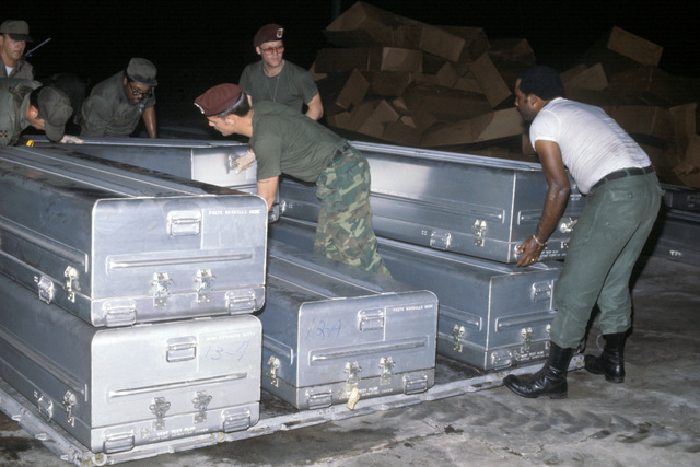US military personnel stack transfer cases containing the remains of the victims of the Jonestown tragedy onto a pallet for shipment to Dover Air Force Base, Delaware