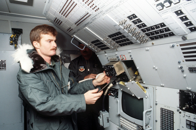 552nd Airborne Warning and Control Wing communications technicians remove a KY-75 control panel from an E-3A Sentry aircraft