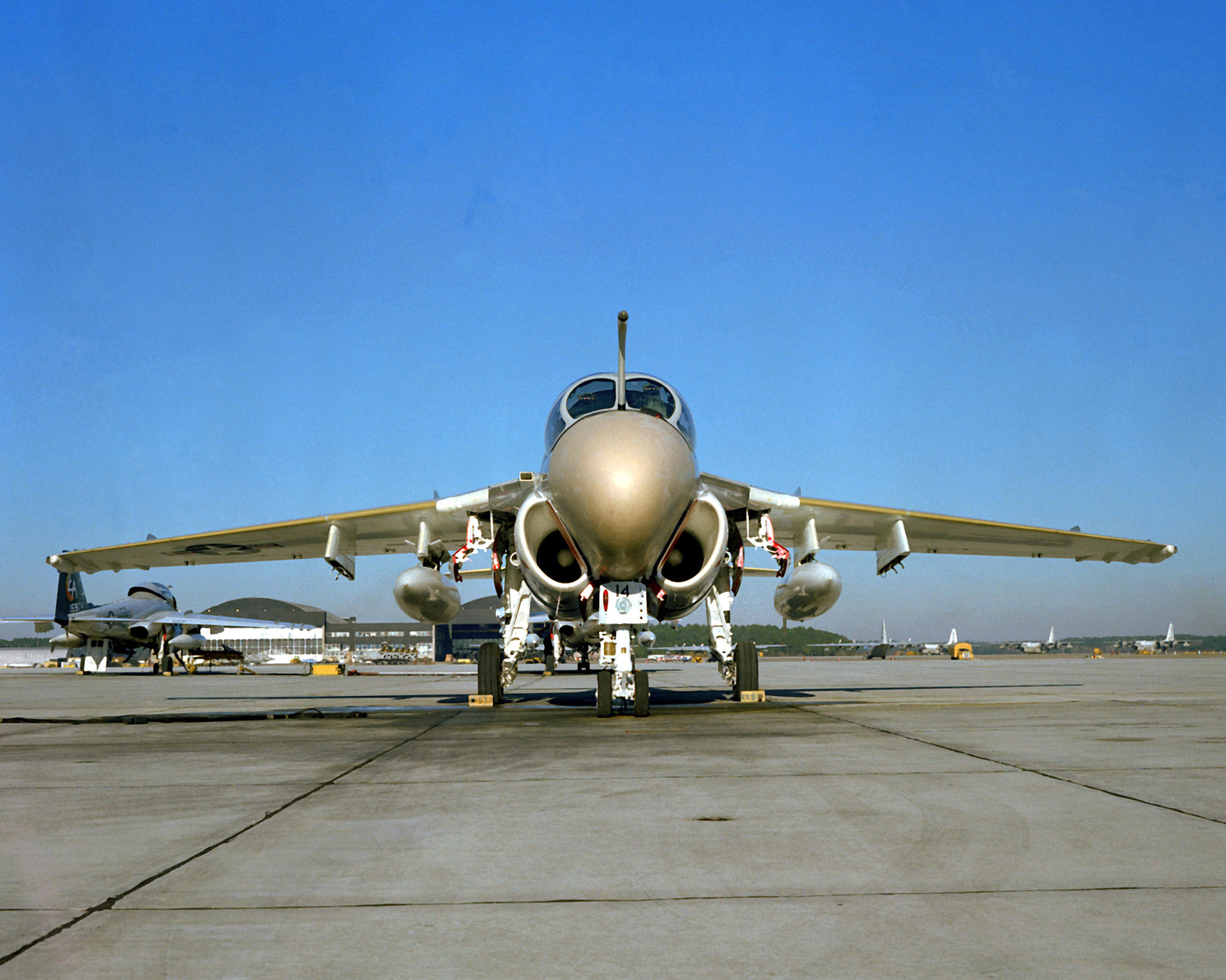 A front view of a Marine A-6E Intruder aircraft sitting on the flight line. The Intruder is from Marine All-Weather Medium Attack Squadron 332 (VMAWF-332)
