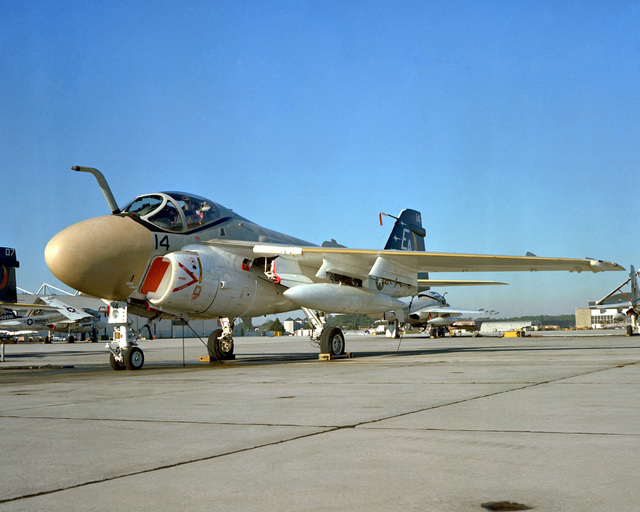 A left front view of a Marine A-6E Intruder aircraft sitting on the flight line. The Intruder is from Marine All-Weather Medium Attack Squadron 332 (VMAWF-332)
