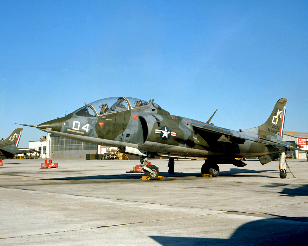A left front view of a Marine TAV-8A Harrier aircraft sitting on the flight line. The Harrier is from Marine Attack Squadron (Training) 203 (VMAT-203)