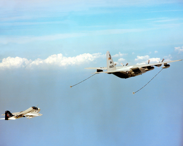 A Marine All-Weather Attack Squadron 332 (VMA(AW)-332) A-6E Intruder aircraft approaches a Marine Refueler-Transport Squadron 252 (VMGR-252) KC-130R Hercules aircraft to take on fuel during a flight out of Marine Corps Air Station, Cherry Point, North Carolina
