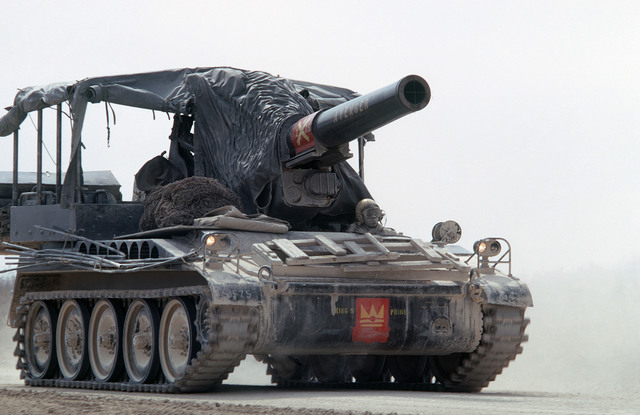 A right front view of an M110 203 mm self-propelled howitzer underway during a training exercise
