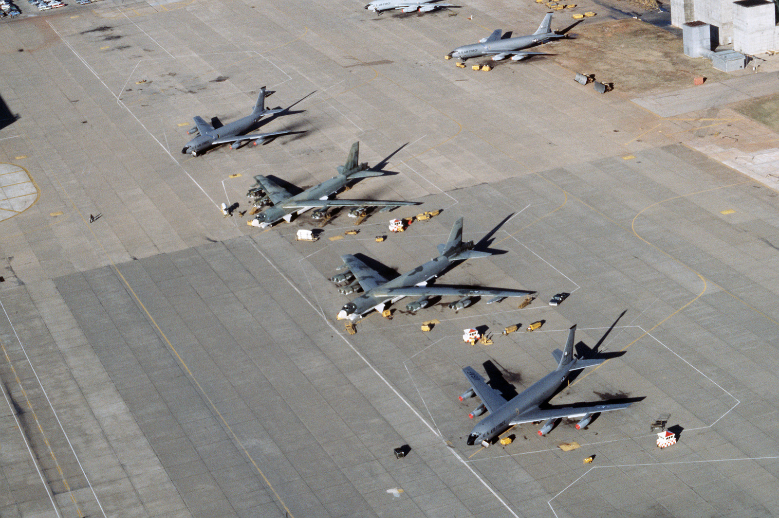 An elevated view of the flight line with two B-52 Stratofortress aircraft flanked by two KC-135 Stratotanker aircraft