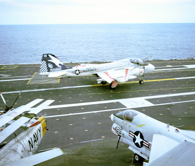 Right side view of a Marine A-6E Intruder aircraft landing on the aircraft carrier USS AMERICA (CV-66) during carrier requalifications. The A-6E from Marine All-Weather Medium Attack Squadron 533 (VMAWF-533)