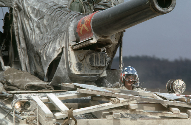 The driver maneuvers an M110 203 mm self-propelled howitzer during a training exercise