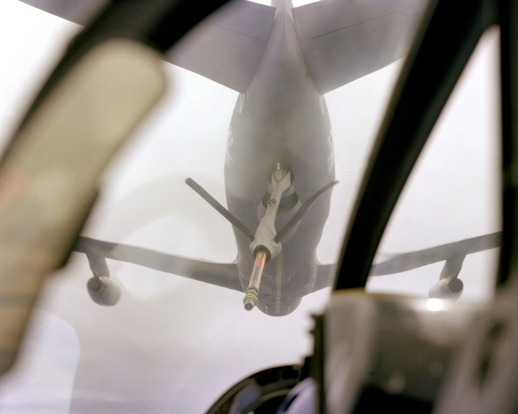 A view from the cockpit of an A-10 Thunderbolt II aircraft as it is about to be refueled by a tanker during a flight to Naval Air Station, Barbers Point, Hawaii