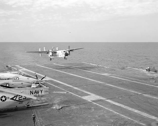 A C-2A Greyhound cargo/transport aircraft from Fleet Logistic Support Squadron 50 (VRC-50) approaches the deck of the aircraft carrier USS KITTY HAWK (CV 63)