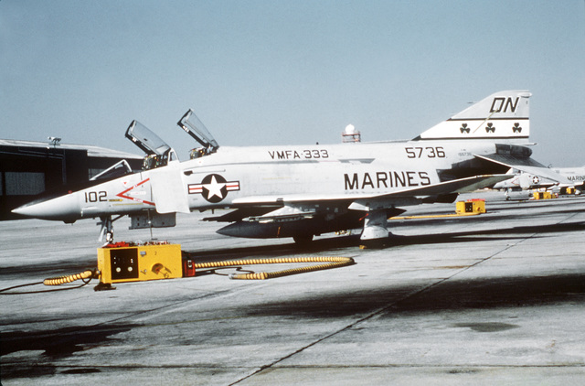 A left front view of a Marine F-4 Phantom II aircraft sitting on the flight line. The F-4 is from Marine Fighter/Attack Squadron 333 (VMFA-333). Exact Date Shot Unknown