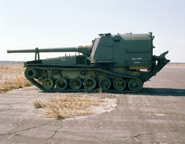 A left side view of an M53 155 mm self-propelled Howitzer used as a target