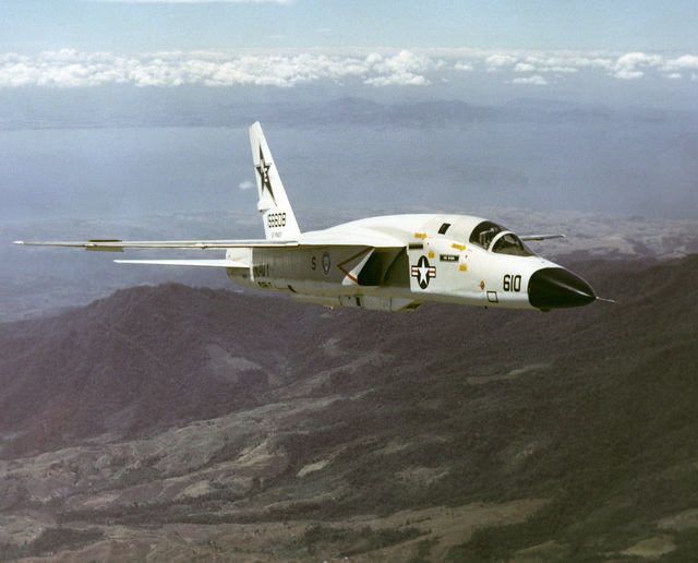 """A three-quarter portside aerial view of an RA-5C Vigilante aircraft, Reconnaissance Attack Squadron 7 (RVAH-7) known as the """"Peacemakers of the Fleet"""" and was assigned to the USS RANGER (CV 61) from February 21 to September 22, 1979. This photograph may show the Vigilante's last flight, since all Vigilante aircraft were officially retired in September 1979 and the RVAH-7 was officially decommissioned in October 1979. The exact date photo taken is unknown"""