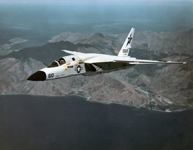 """A three-quarter starboard aerial view of an RA-5C Vigilante aircraft, Reconnaissance Attack Squadron 7 (RVAH-7) known as the """"Peacemakers of the Fleet"""" and was assigned to the USS RANGER (CV 61) from February 21 to September 22, 1979. This photograph may show the Vigilante's last flight, since all Vigilante aircraft were officially retired in September 1979 and the RVAH-7 was officially decommissioned in October 1979. The exact date photo taken is unknown"""