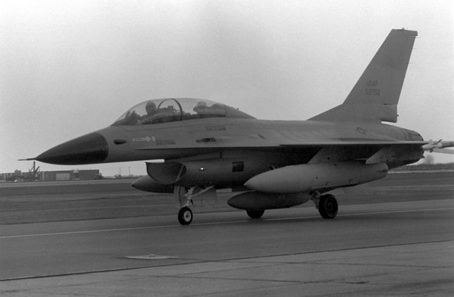 A view of a pre-production U.S. Air Force F-16B Fighting Falcon aircraft, as it taxies down the runway. The aircraft is here for European tests and evaluations