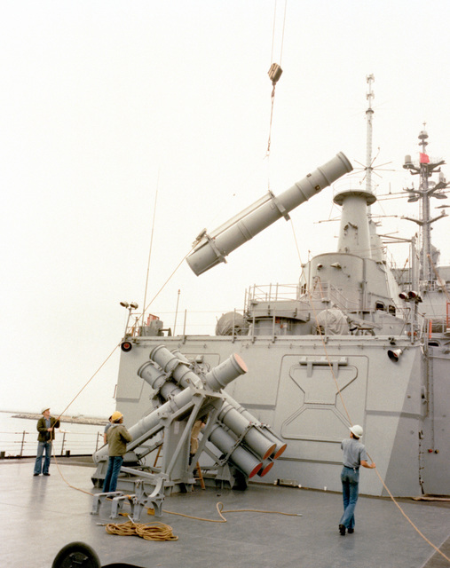 AGM-84 Harpoon surface-to-surface missile canisters are loaded aboard the nuclear-powered guided missile cruiser USS LONG BEACH (CGN-9)