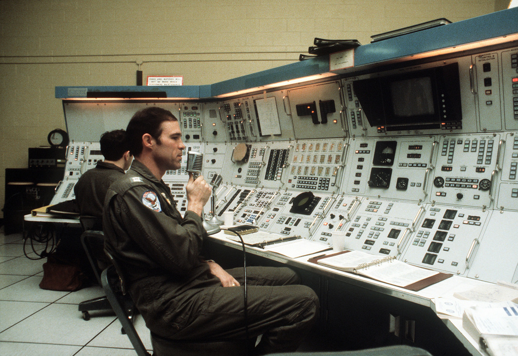 """An Air Force captain monitors a control panel at the headquarters building, the """"Mole Hole,"""" of the 509th Bombardment Wing"""