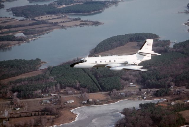 An air-to-air left side view of an 89th Military Airlift Wing C-140B Jet Star aircraft