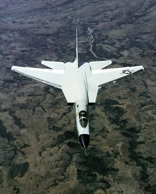 """An overhead aerial view of an RA-5C Vigilante aircraft, Reconnaissance Attack Squadron 7 (RVAH-7) known as the """"Peacemakers of the Fleet"""" and was assigned to the USS RANGER (CV 61) from February 21 to September 22, 1979. This photograph may show the Vigilante's last flight, since all Vigilante aircraft were officially retired in September 1979 and the RVAH-7 was officially decommissioned in October 1979. The exact date photo taken is unknown"""