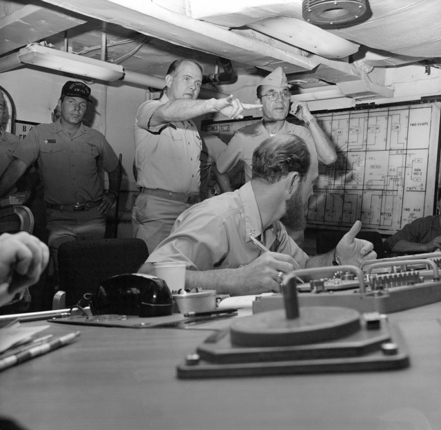 Rear Admiral Lawrence Chambers (right), commander, Carrier Group Three, tours damage control central aboard the aircraft carrier USS CORAL SEA (CV 43)