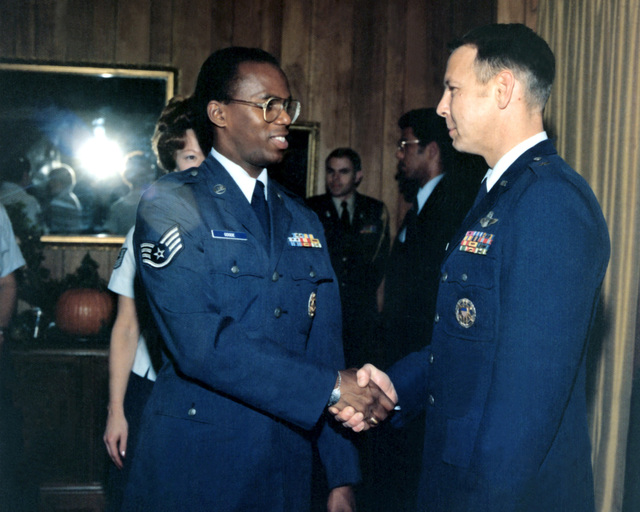 SSGT Reese Goode shakes hands with BGEN Harold W. Tood, executive assistant to the chair, Joint Chiefs of STAFF