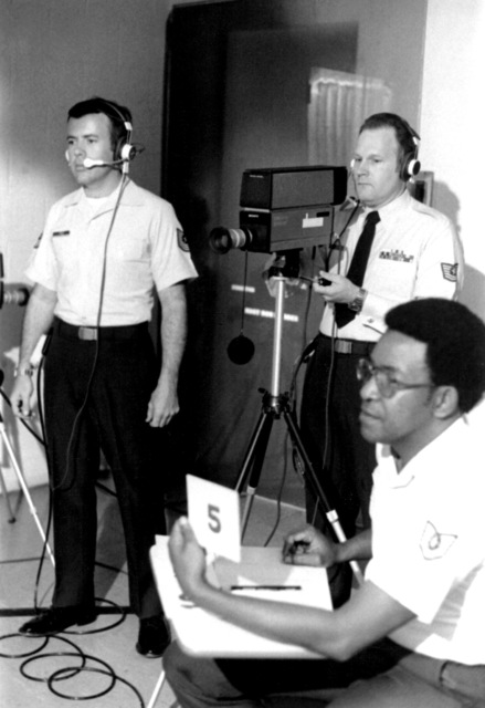 TSGT Brad McClain, right, awards five points to a Challenge 79 contestant while MSGT Phil Volz, left, and TSGT Dave McKinney operate the cameras. Challenge 79 is a closed circuit television game show aired at the Strategic Air Command Non-Commissioned Officer Academy