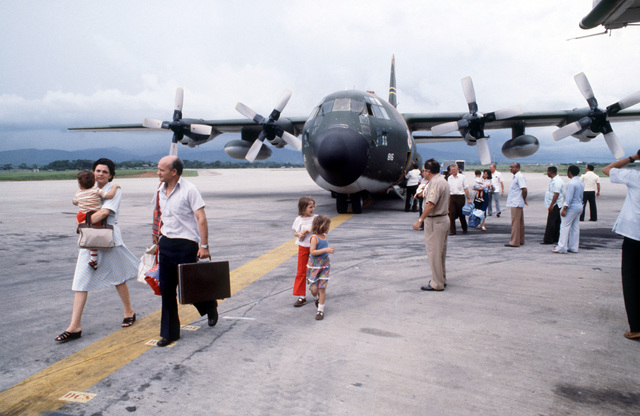 US citizens and foreign nationals arrive at Tocumen International Airport aboard a US Air Force Reserve C-130E Hercules aircraft after being evacuated from war-torn Nicaragua