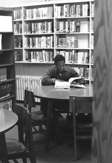 CPL Reginald Gillispie takes time to catch up on his reading at the station library