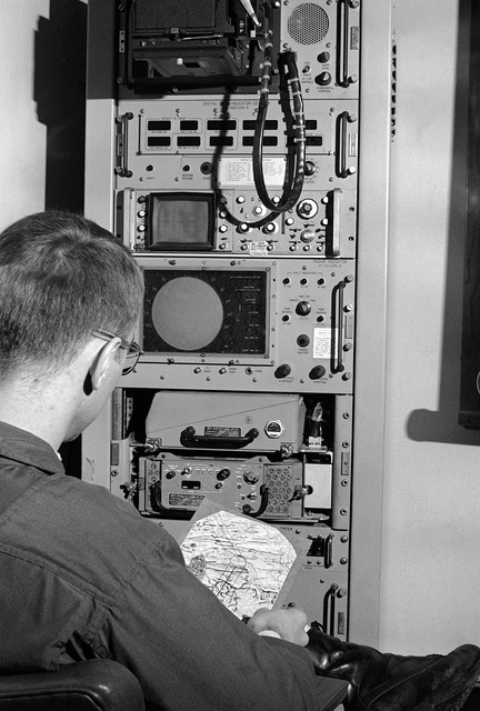 A pilot from the Marine All-Weather Attack Squadron 202 (Training), studies one of his readouts (chart) on a practice flight