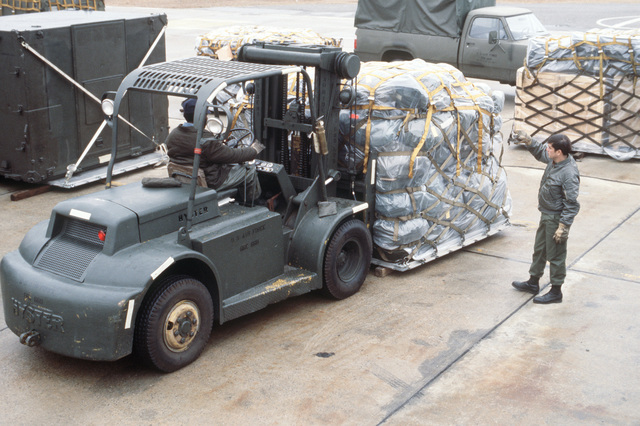 """Members of the 5th Combat Communications Group use a fork lift to move a pallet of supplies on the flight line. The supplies will be flown to Alaska for use during Exercise JACK FROST """"79"""