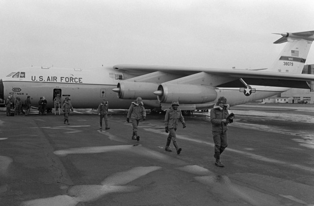 US Army troops exit from an Air Force C-141 Starlifter aircraft during a stopover while en route to West Germany for Exercise REFORGER 79