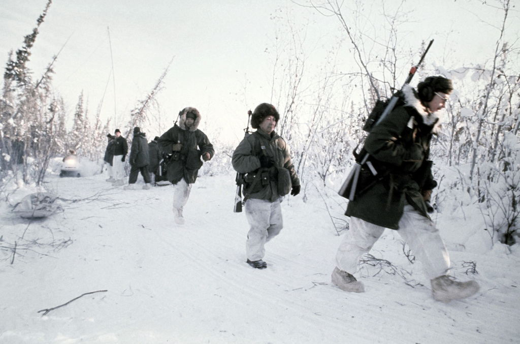 Members of Company A, 2nd Battalion, Army Special Forces, and Company B, 297th Infantry, Eskimo Scouts, move out on a reconnaissance mission during Exercise JACK FROST '79