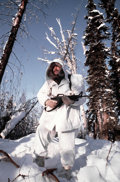 SPECIALIST Fourth Class Lester Pope of Company A, 2nd Battalion, Army Special Forces, departs on a reconnaissance mission wearing snowshoes during Exercise JACK FROST '79