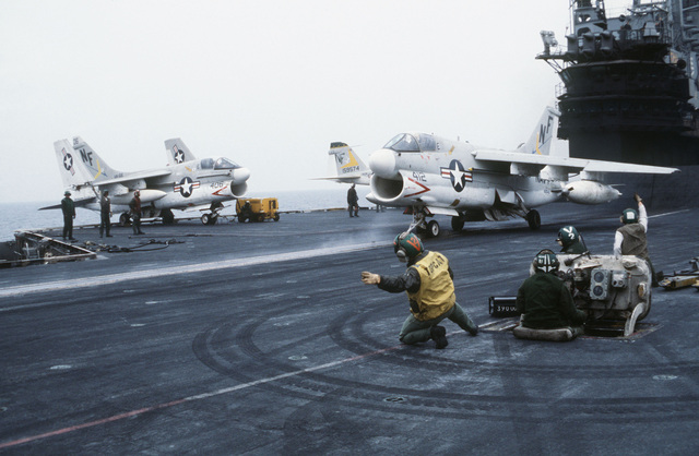 A Navy A-7E Corsair aircraft is prepared for launching for the aircraft carrier USS MIDWAY (CV 41), off the coast of Korea during the joint ROK/US training exercise TEAM SPIRIT '79