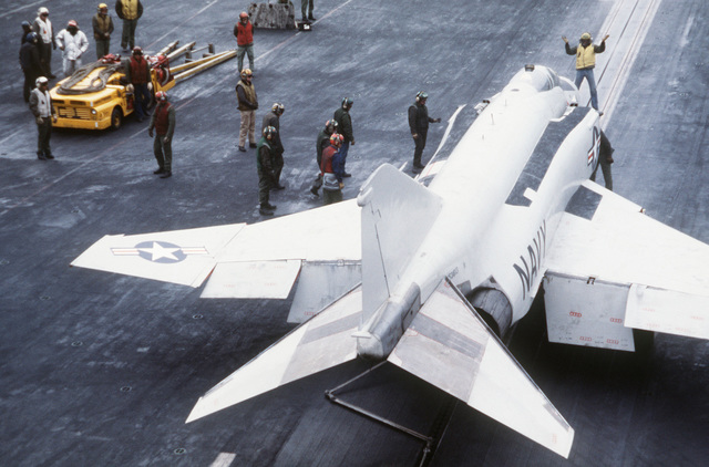A Navy F-4J Phantom aircraft is prepared for launching from the aircraft carrier USS MIDWAY (CV 41), off the coast of Korea during the joint ROK/US training exercise TEAM SPIRIT '79