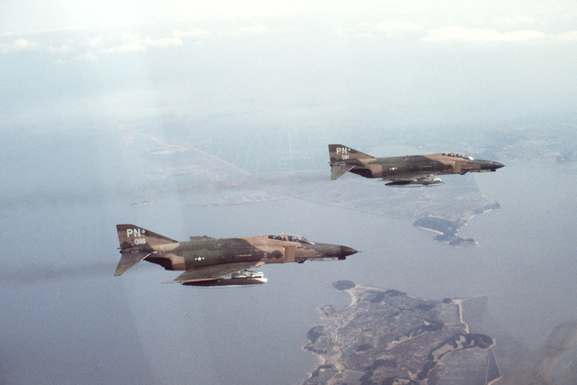 An air-to-air right side view of two F-4E Phantom II aircraft assigned to the 3rd Tactical Fighter Wing during the joint ROK/US training exercise TEAM SPIRIT '79
