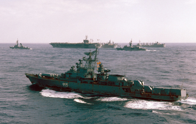 A port quarter view of a Soviet Krivak I class guided missile frigate observing Carrier Battle Group Eight off the coast of Lebanon. The ships are, left to right: the guided missile destroyer USS RICHARD E. BYRD (DDG 23), nuclear-powered aircraft carrier USS NIMITZ (CVN 68), replenishment oiler USS KALAMAZOO (AOR 6) and the frigate USS W.S. SIMS (FF 1059)