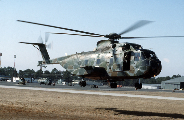 A right side view of a 20th Special Operations Squadron CH-3 Sea King helicopter taking off during Exercise J-CATCH, a joint rotary wing and fixed wing tactics development and capability evaluation