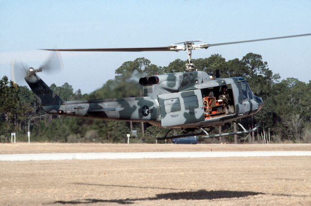 A right side view of a 20th Special Operations Squadron UH-1N Iroquois helicopter taking off during Exercise J-CATCH, a joint rotary wing and fixed wing tactics development and capability evaluation