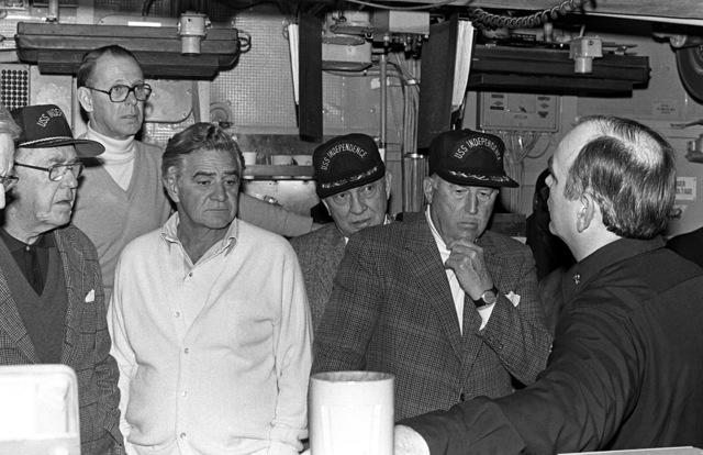 Undersecretary of the Navy Robert Baldwin, left rear, and members of his party are given a tour of the combat information center (CIC) during their visit aboard the aircraft carrier USS INDEPENDENCE (CV-62)