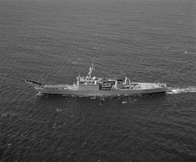 An elevated port view of the tank landing ship USS CAYUGA (LST-1186) underway