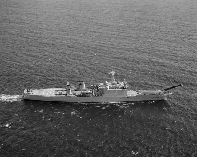 An elevated starboard beam view of the tank landing ship USS CAYUGA (LST 1186) underway